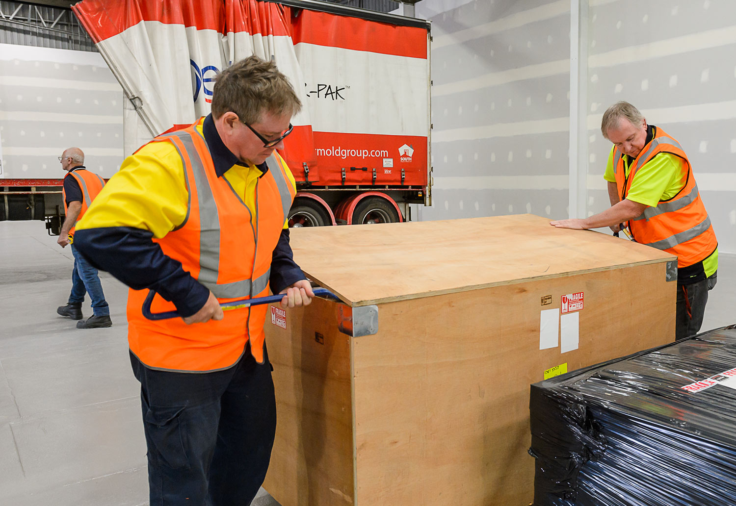Detmold Group staff unpack machines to establish manufacturing facility