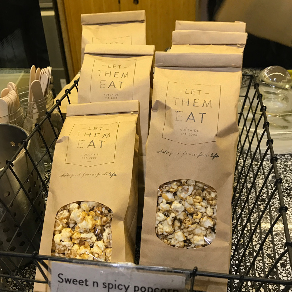 Let them eat Popcorn in window retail bags with tin tie