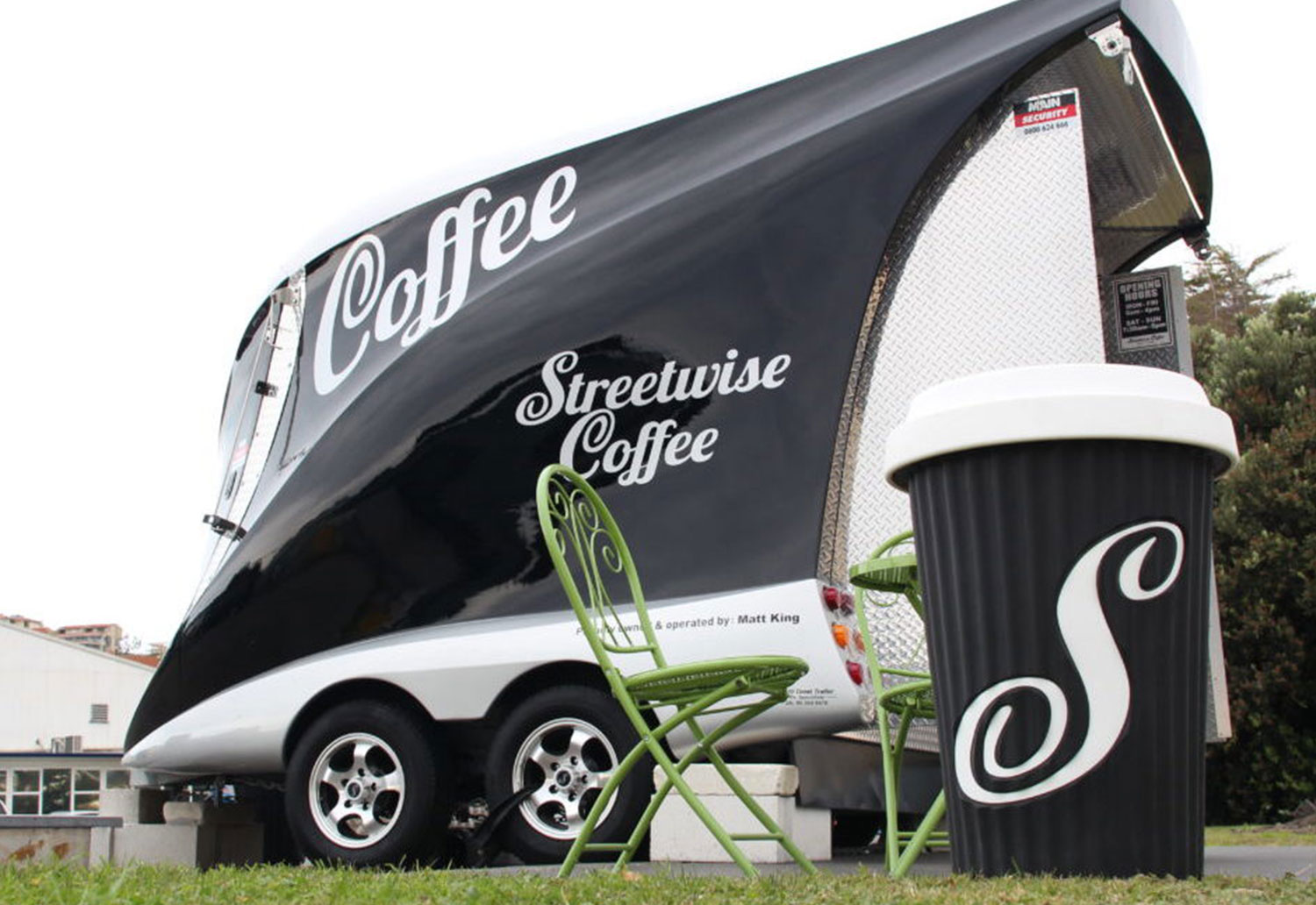 Image of a Streetwise Coffee Cart with takeaway cup in front