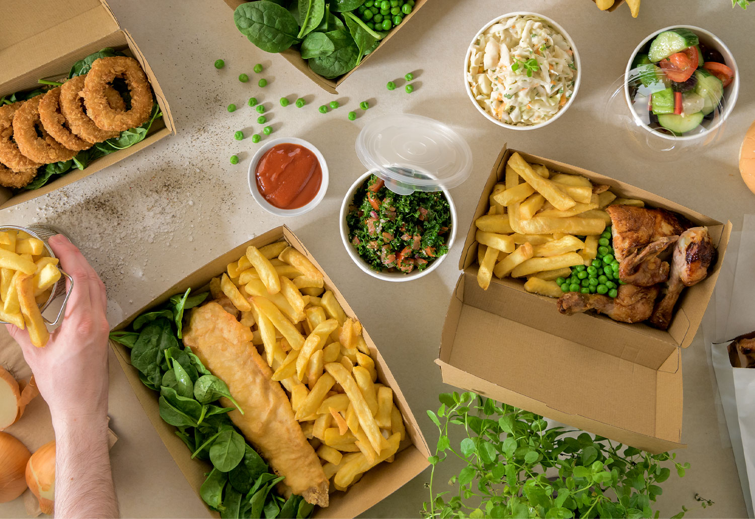 Images of takeaway packaging, with food efficiently packed inside