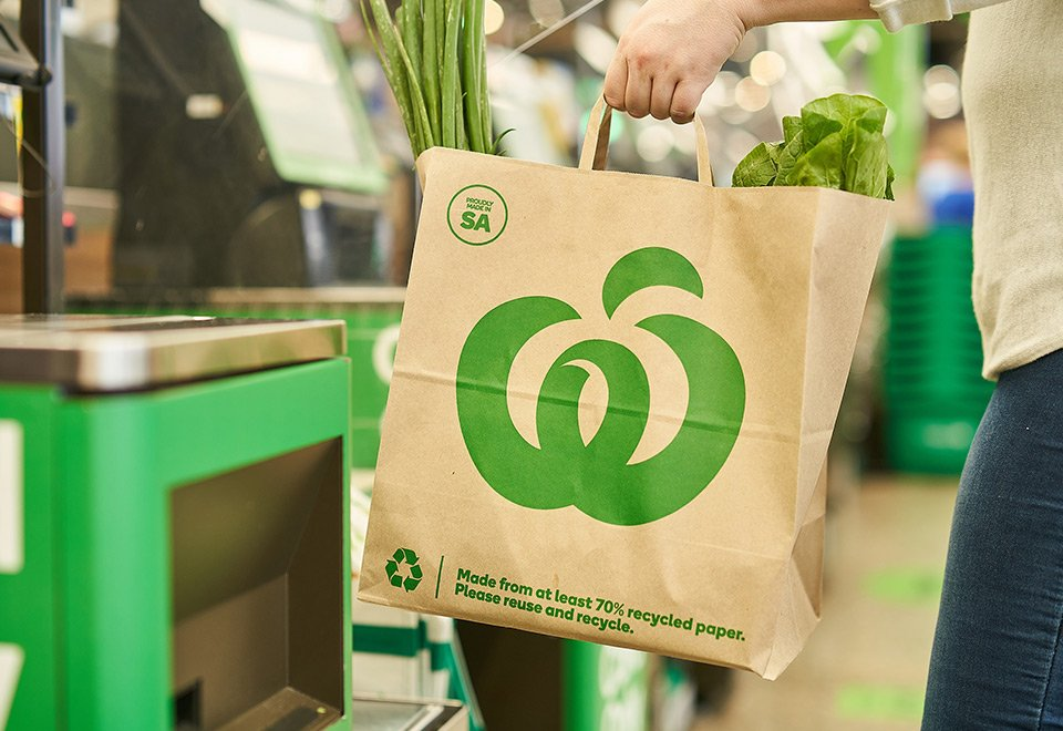 Woolworths paper bag being used in-store