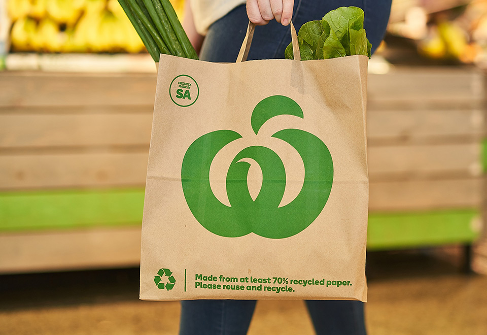 Image of Woolworths bag in use at a supermarket