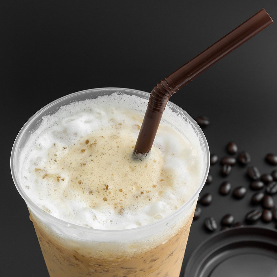 Image of plastic cup and plastic straw on dark background
