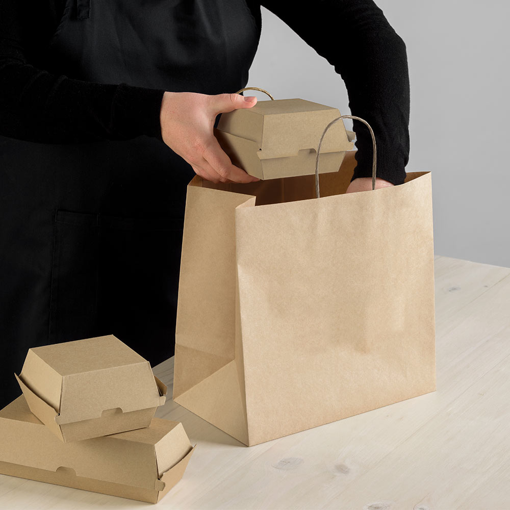 Image of food being lifted into a Detpak carry bag