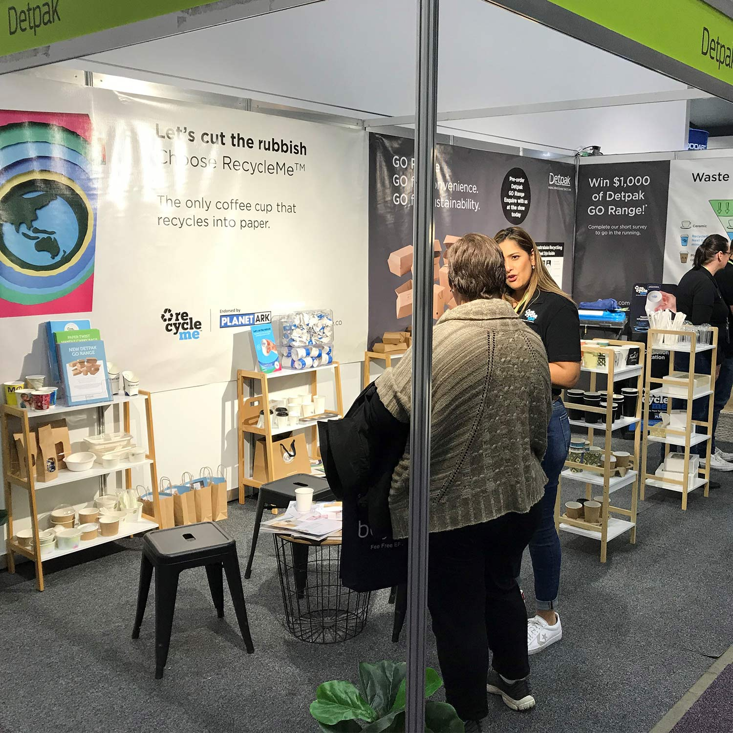 Image of stand at FoodService Australia with RecycleMe banner in background