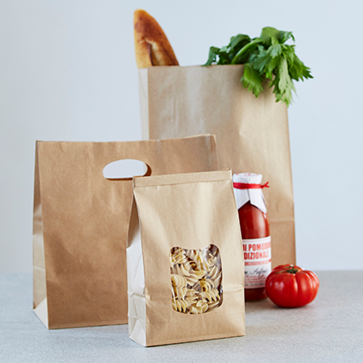 Image of three paper bags with groceries inside