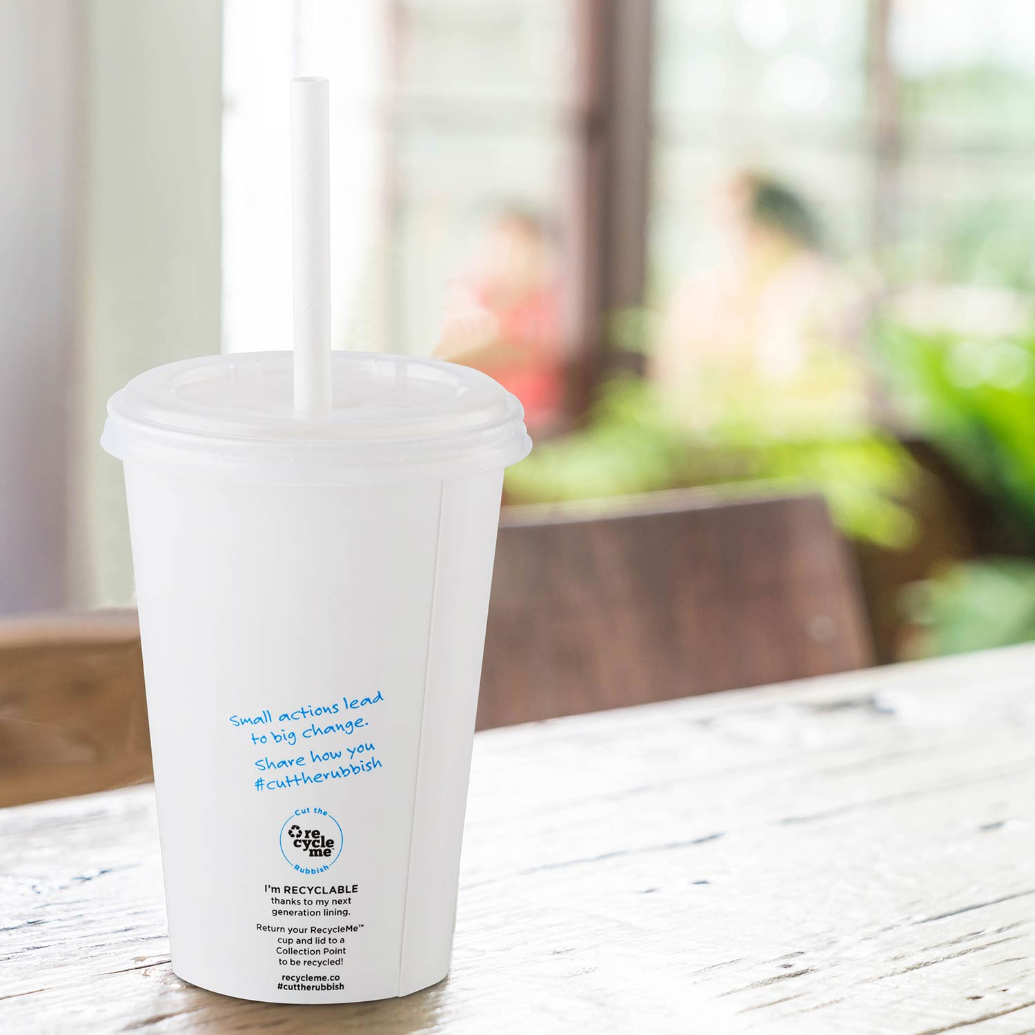 Image of Detpak RecycleMe Cold Cup on table in cafe
