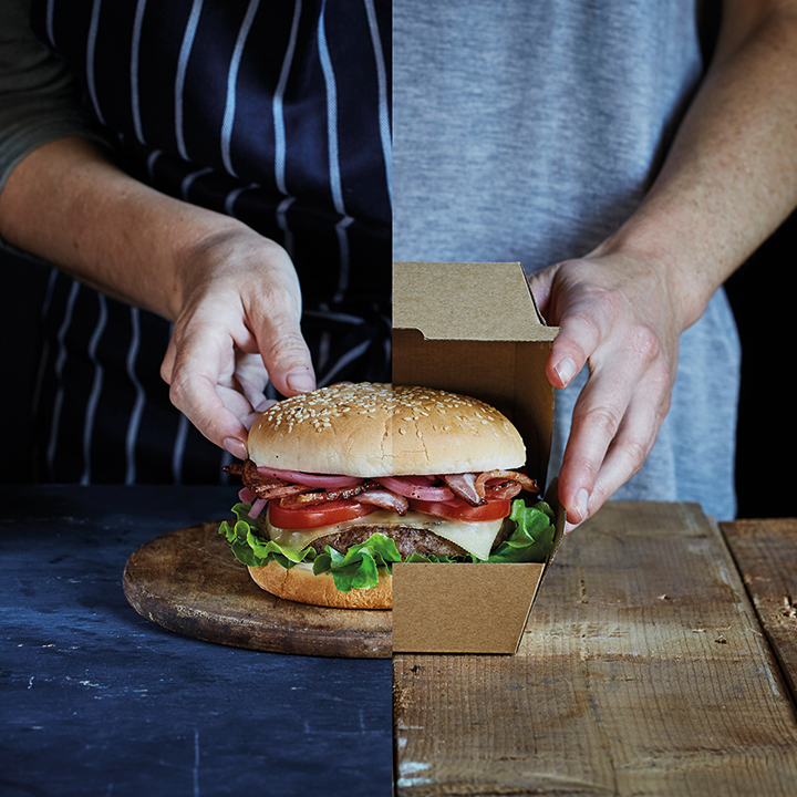 burger on wooden bench