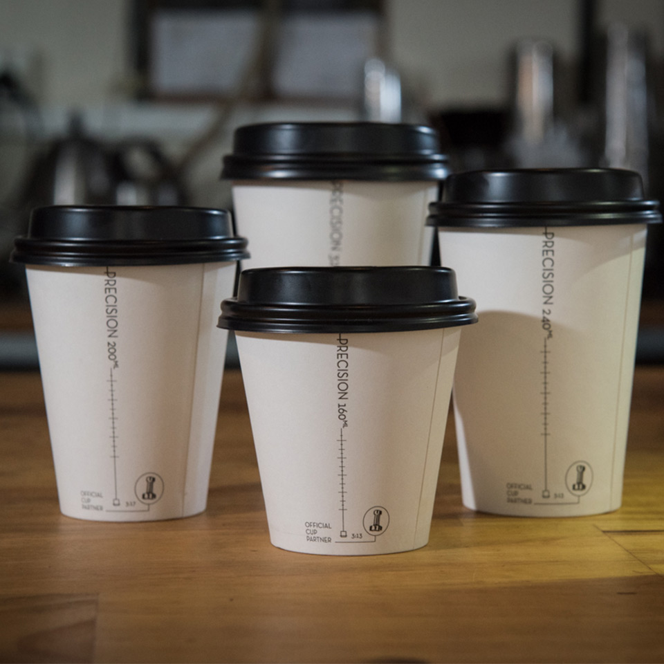Image shows the four different Precision Series takeaway cup sizes in a group shot on a table
